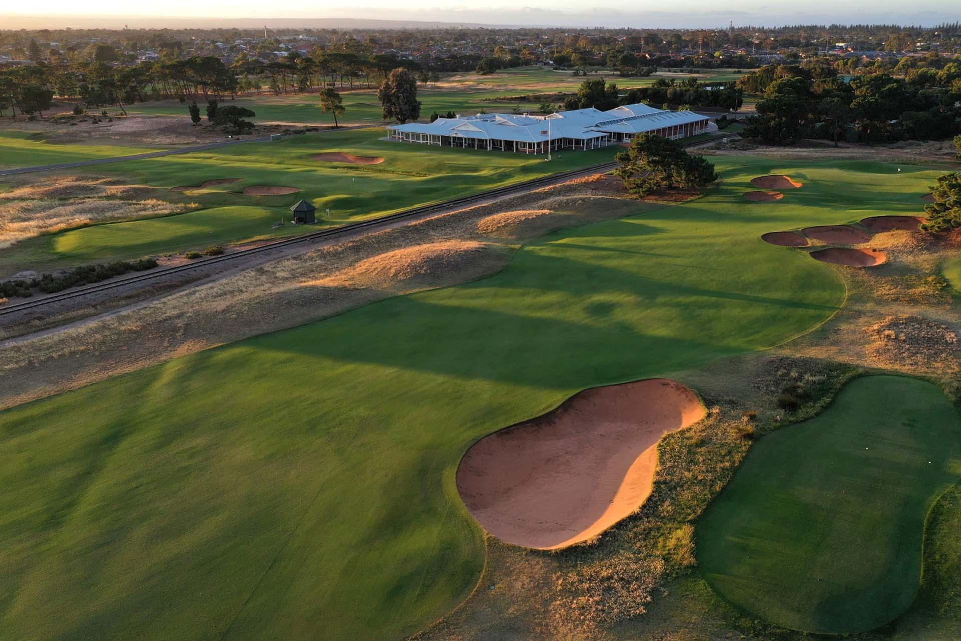 Royal Adelaide Golf Club - Par 5, 2nd Green, Railway Line & Clubhouse / Photo: Gary Lisbon Golf Photography
