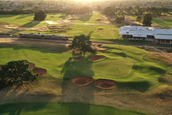 Royal Adelaide Golf Club - Par 5, 2nd Hole, Par 4, 18th Hole, Railway Line & Clubhouse / Photo: Gary Lisbon Golf Photography
