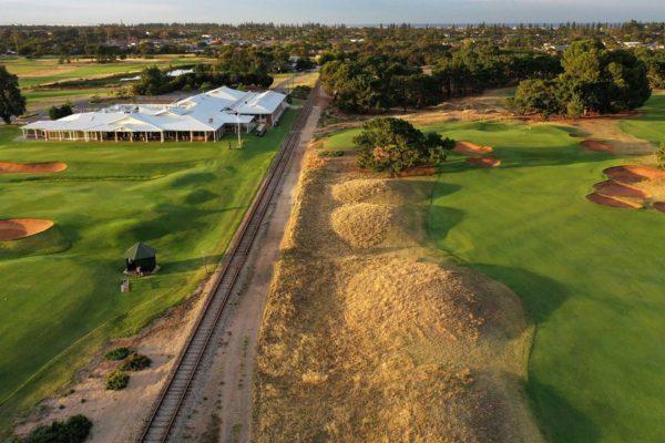 Royal Adelaide Golf Club - Par 5, 2nd Hole, Railway Line & Clubhouse / Photo: Gary Lisbon Golf Photography